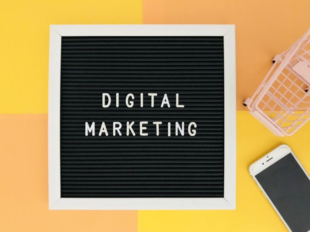 Digital marketing board on yellow and coral background